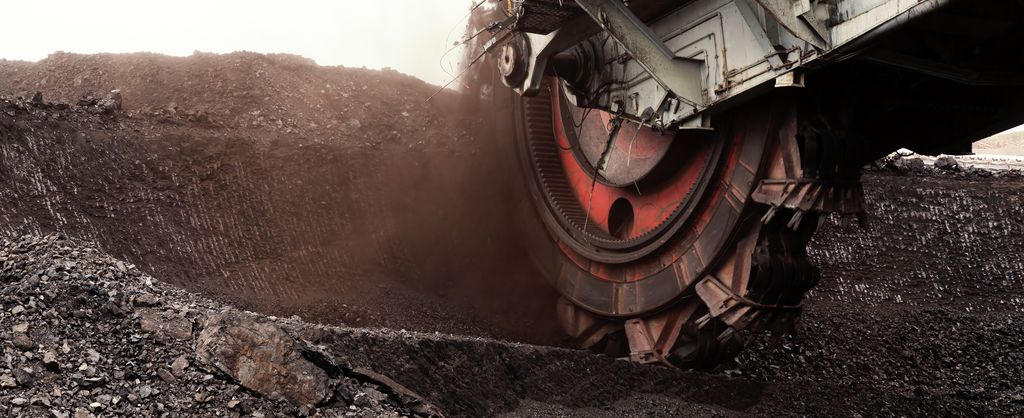 Background image - industry solution mining - view on a huge excavator in the coal mining