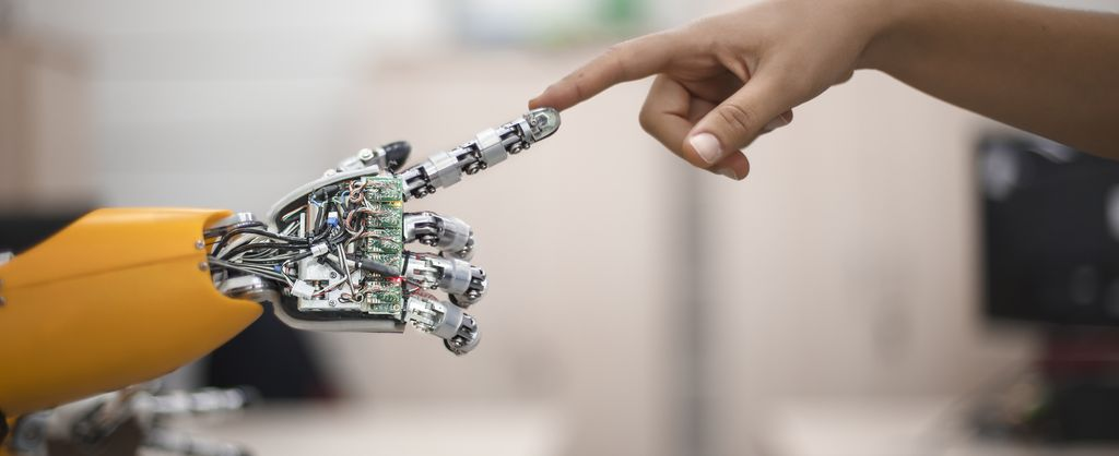 Background image - department solution engineering - view human hand touches robot arm